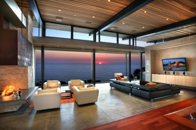 Panoramic-ocean-view-in-modern-living-room-with-big-screen-TV