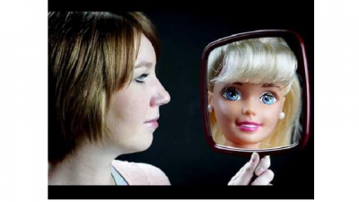 This is a picture of a women looking at fake version of herself.