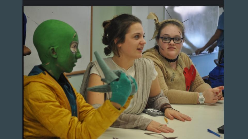 Students in class with their costumes on