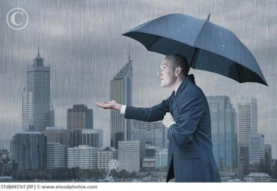 businessman_with_umbrella_in_the_rain_27dlj0023rf